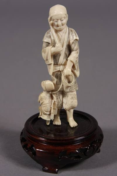 16: Carved Ivory Figure of a Man with Monkey, Japanese