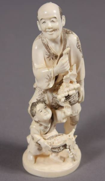 20: Carved Ivory Figure of a Man and Boy with Grapes