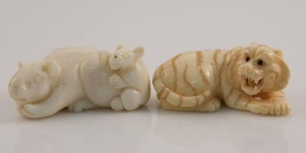 12: Two Carved Ivory Netsuke, a Rat and a Tiger