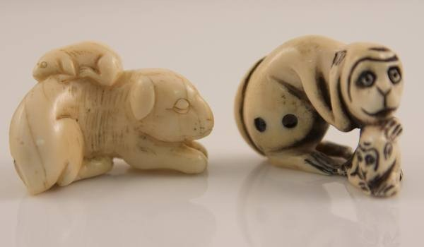 17: Two Carved Ivory Netsuke, a Monkey and a Dog