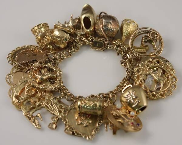 01c5b9021f081 177: Charm Bracelet, 14K Yellow Gold, With 32 Charms