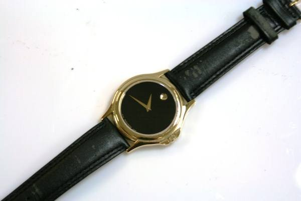 190: Movado Watch With Black Dial & Yellow Gold Accents