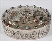 Oval Silver Box with Ivory Miniatures