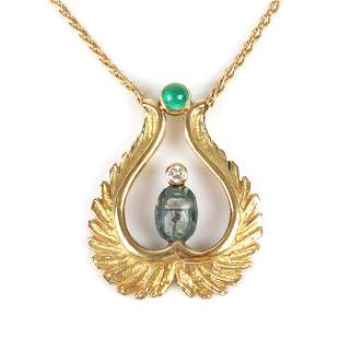 Stamped 750 18K yellow gold Egyptian Revival pendant