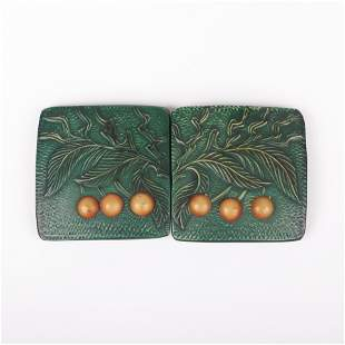 Large Art Nouveau green overdyed embossed celluloid