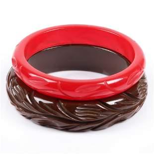 Two vintage Bakelite carved bangle bracelets with