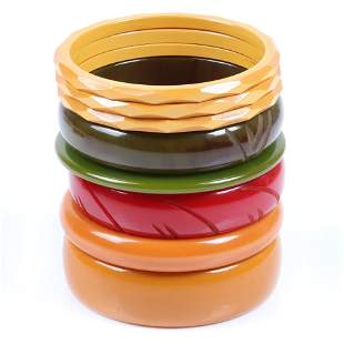 A tower of Bakelite bangle bracelets in green, gold and