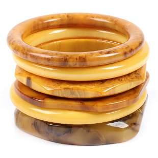 Six Bakelite butterscotch and swirl bangle bracelets: