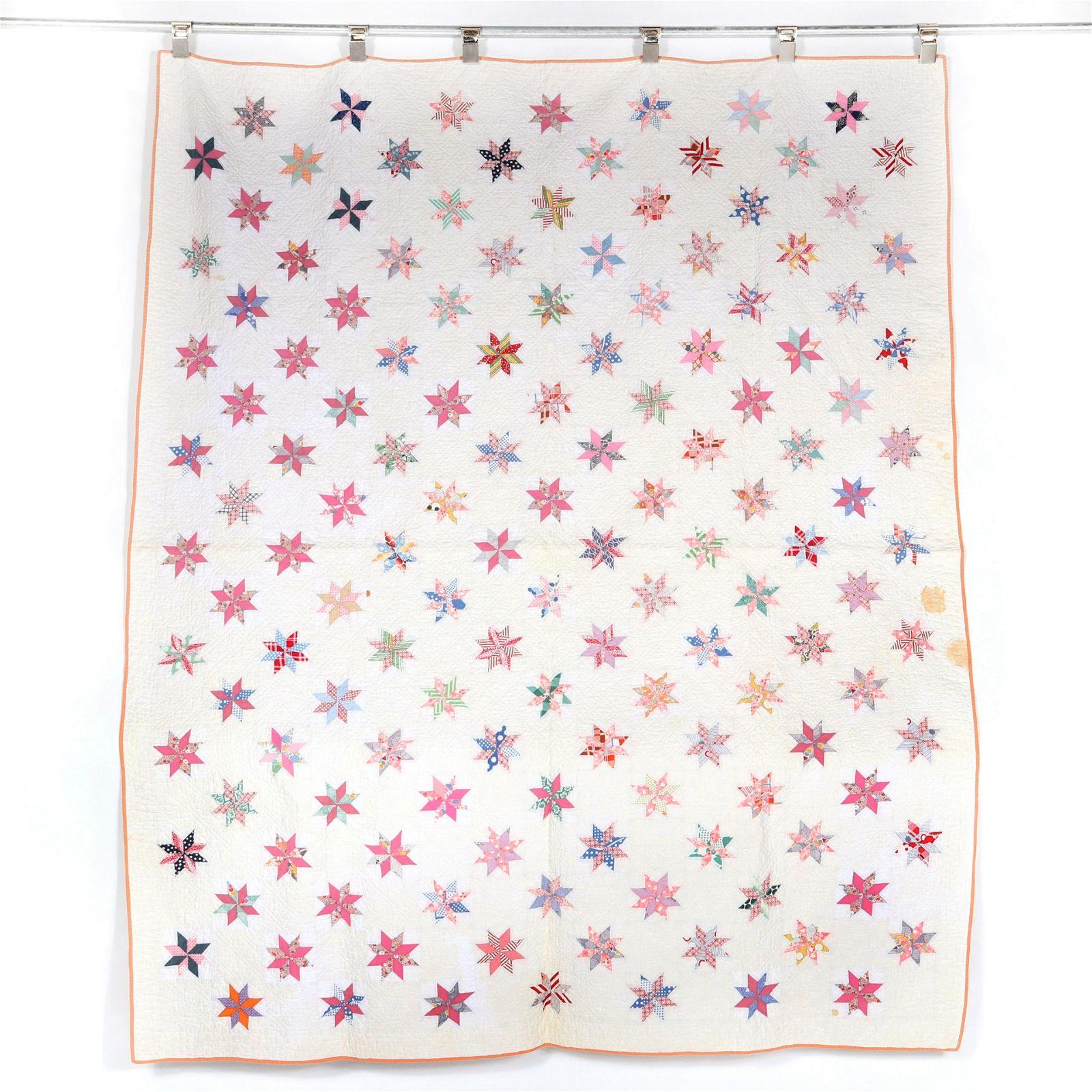 Vintage handmade 1930's floating stars quilt
