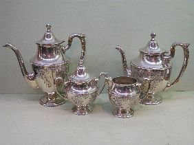 392: 4 PC DUNKIRK HAND CHASED STERLING TEASET