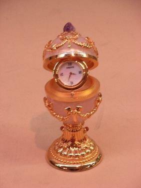 415: FABERGE ROSE QUARTZ EGG WITH CLOCK