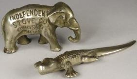 Two Cast Iron Figural Advertising Paperweights
