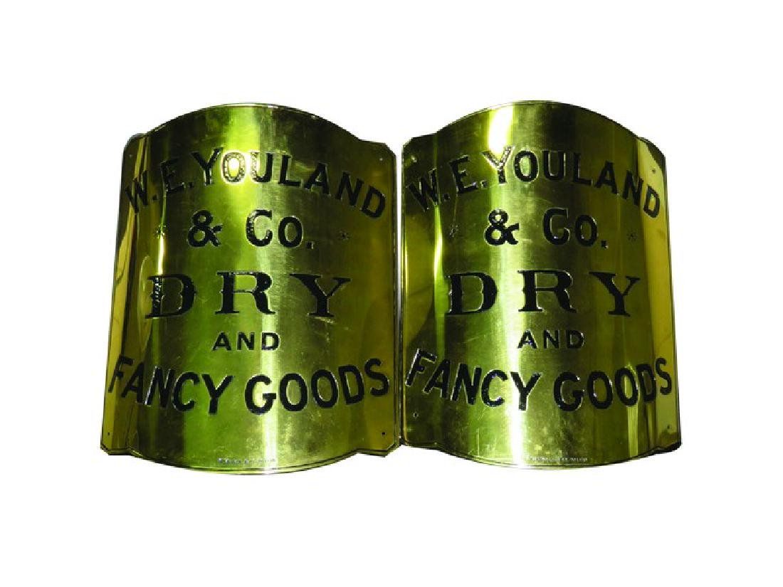Two Curved Brass Food Signs