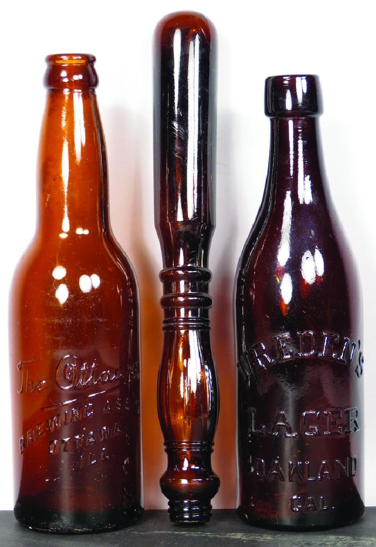 Three Amber Whiskey Bottles