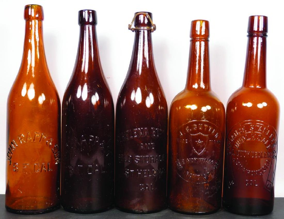 Collection of Embossed Amber Liquor Bottles