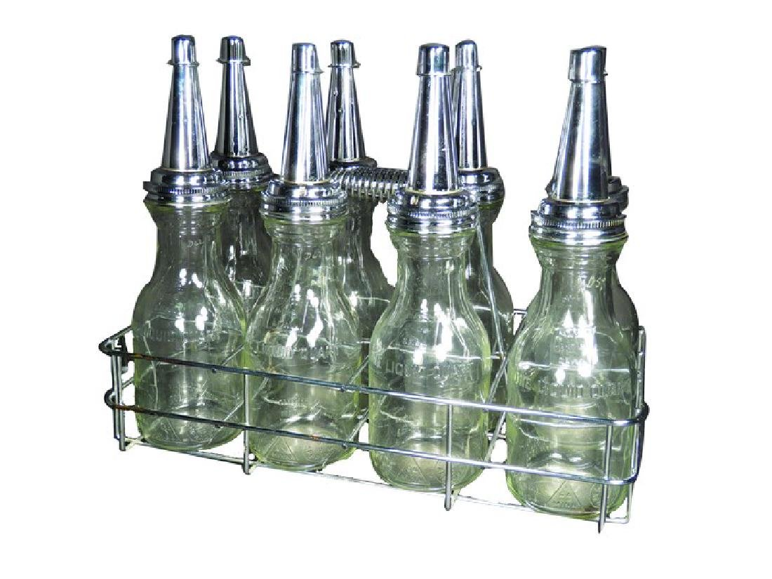 Eight Oil Bottles, Quart size in wire carrier