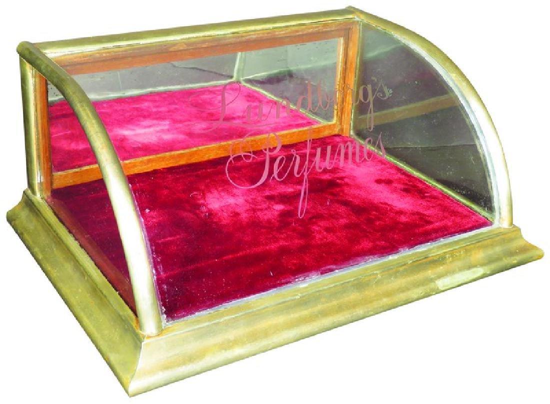 Lundborg's Perfumes Curved Glass Nickel Showcase