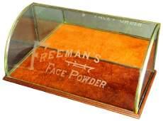 Freeman's Face Powder Curved Glass Showcase