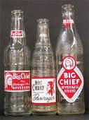 Three Coca Cola Big Chief Beverage Bottles