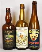 Three Brown Liquor Bottles