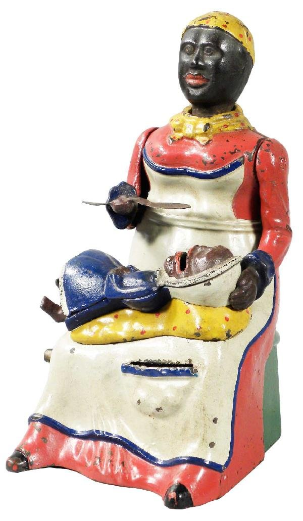 1308: Cast Iron Mechanical Bank, Mammy with spoon