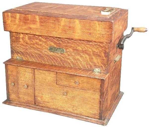 1504: Tiger Oak Coin Sorter, patented Nov. 12, 1901