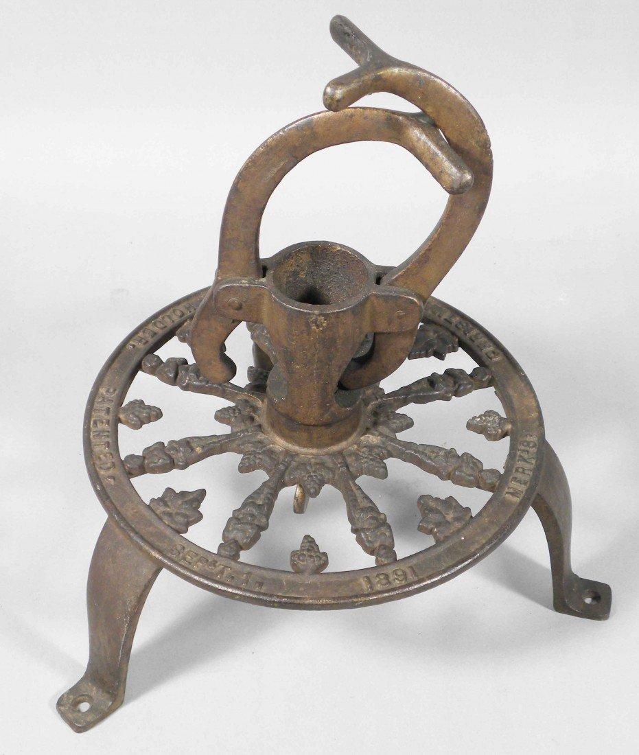 1315: Merk's Cast Iron Christmas Tree Holder