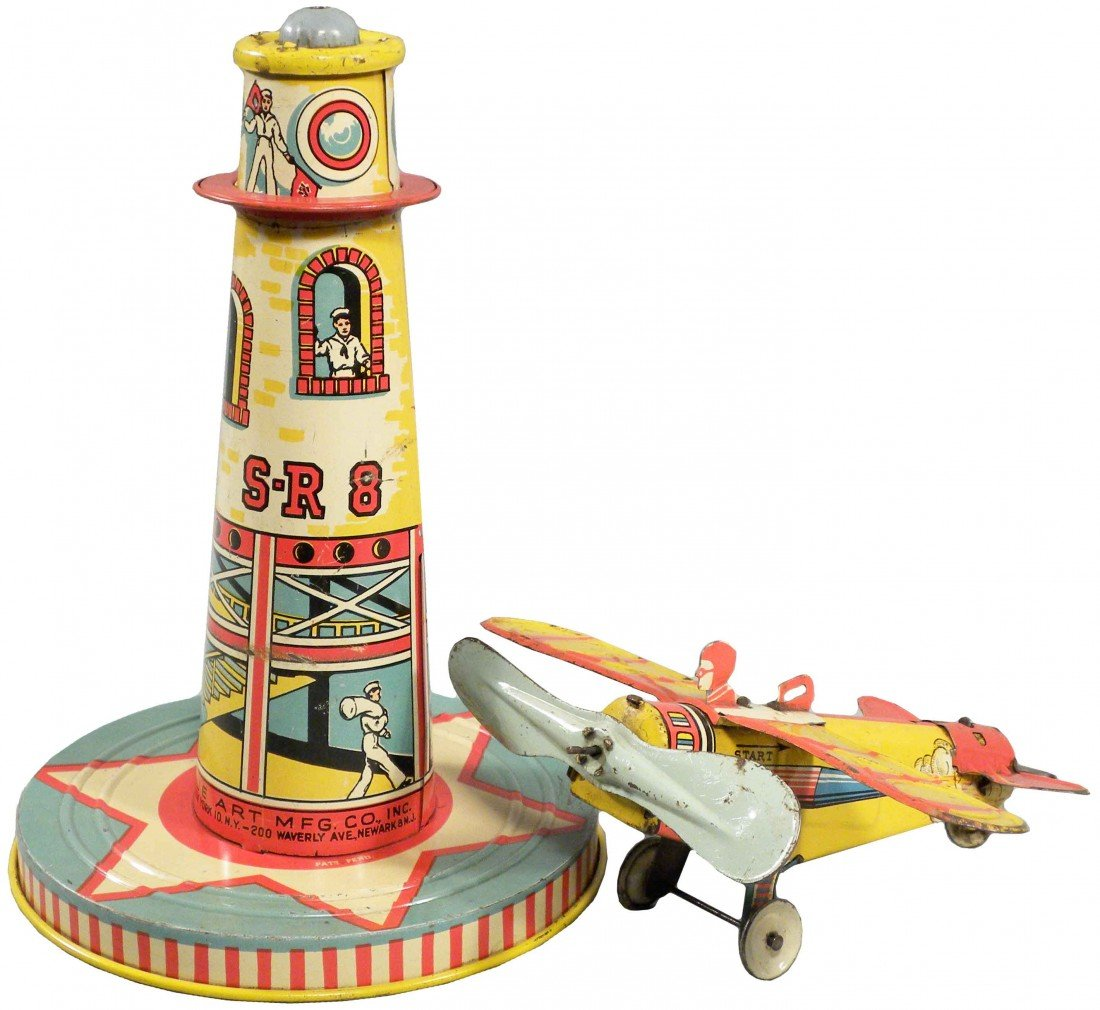 1555: Tin Airport Tower with airplane Toy