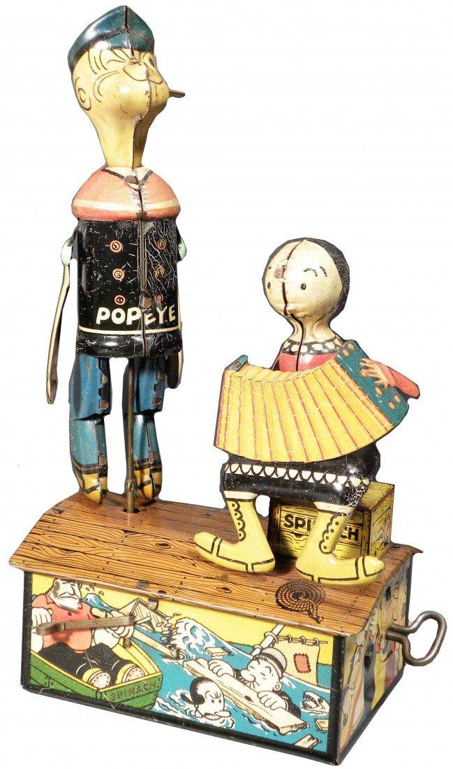 "1557:  Louis Marx. Tin Wind-Up ""Popeye & Olive Oil"""