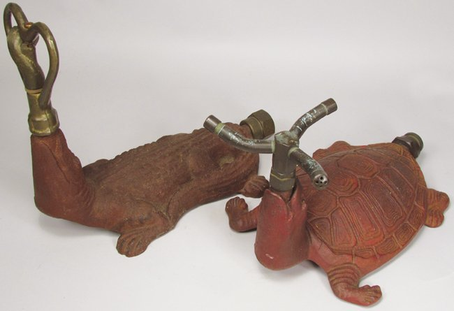 Two Cast Iron Figural Lawn Sprinklers