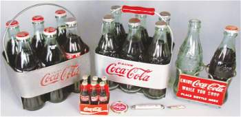Collection of Coca Cola Bottle Items