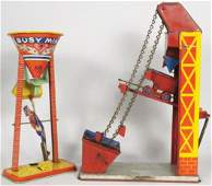 Two Vintage Tin Wind Up Construction Toys