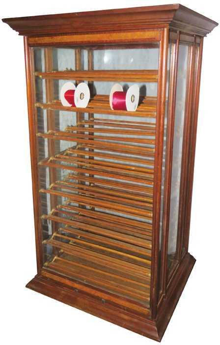 - A.N. Russell & Sons Oak Ribbon Cabinet