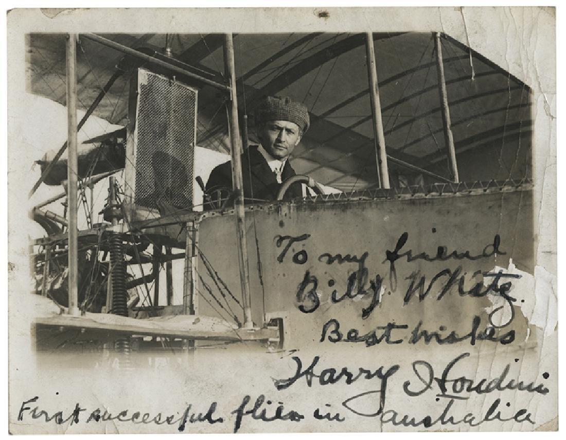 Inscribed and Signed Photograph of Houdini Piloting his