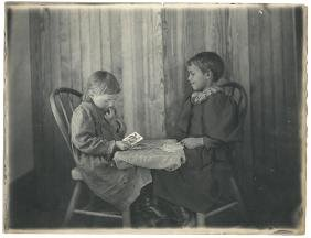Three Photographs of Children Playing Cards.
