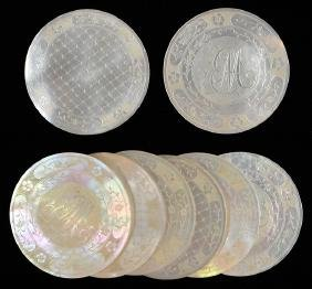 Set of Eight Mother of Pearl Gambling Chips.