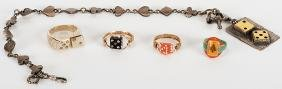 Five Pieces of Vintage Gambling-Themed Jewelry.