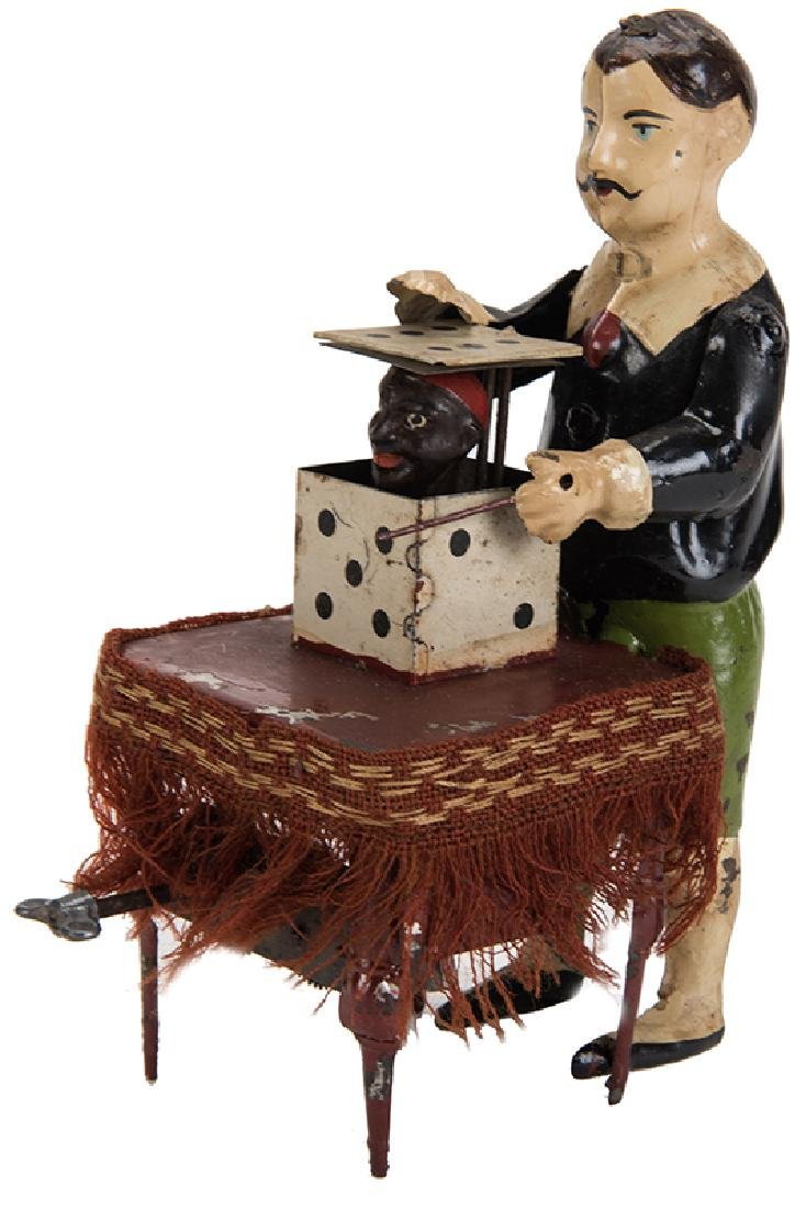 Antique Wind-Up Magician Toy.