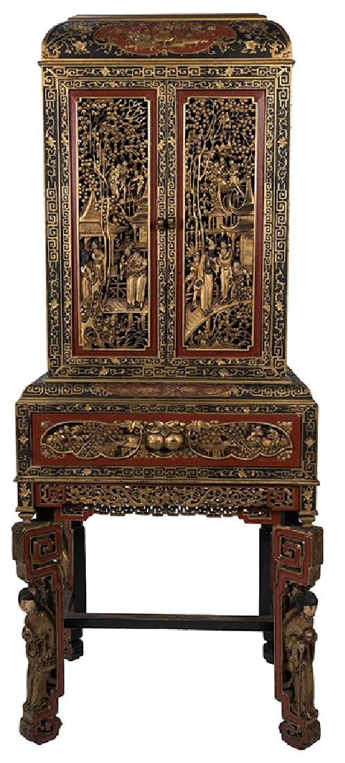 A Large and Ornately Carved Chinese Cabinet on Stand.