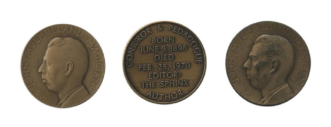 Three John Mulholland Magic Tokens.