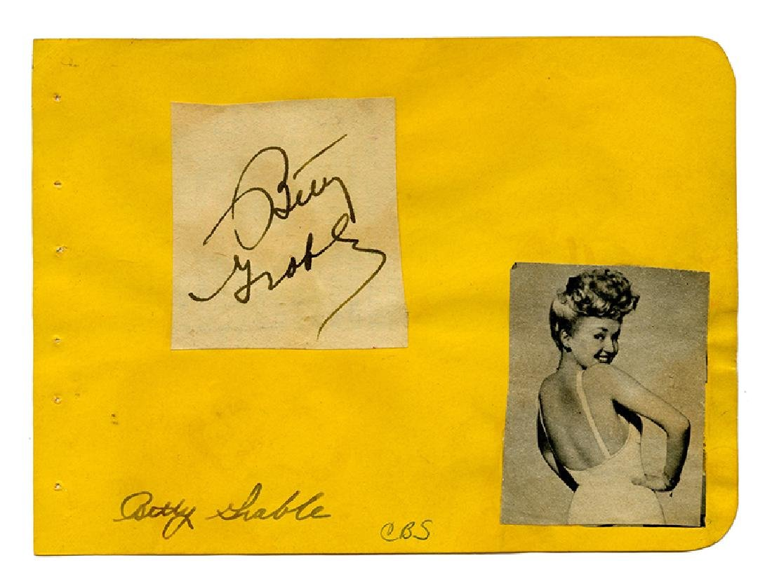 Film actors' signatures on cards and album pages.