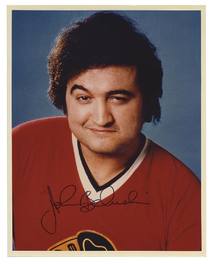 Autographed full color photograph of John Belushi.