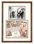 Framed lobby card and signed photo of John Wayne