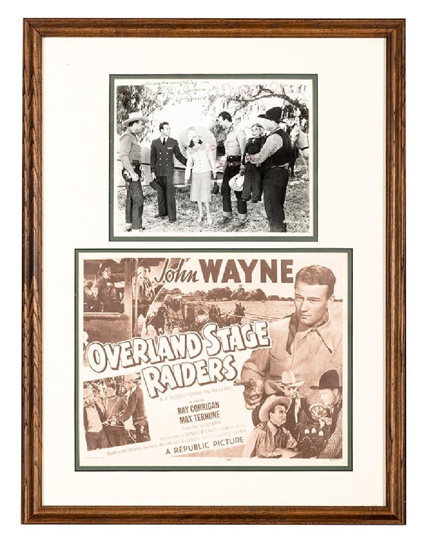 Framed lobby card and signed photo of John Wayne.