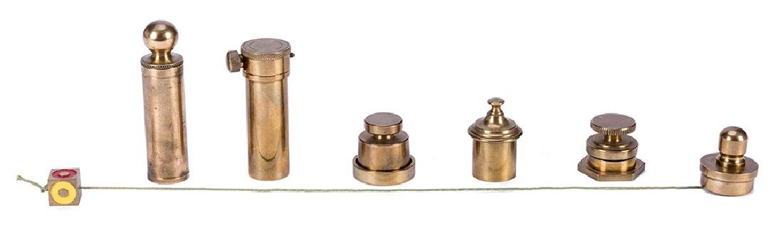 Collection of Seven Brema-Made Brass Pocket Tricks.
