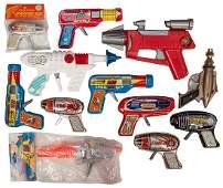 A Dozen Vintage Space Gun Toys.