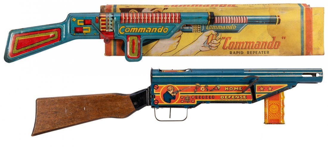 Pair of Tin Litho Toy Rifles. Including a Commando