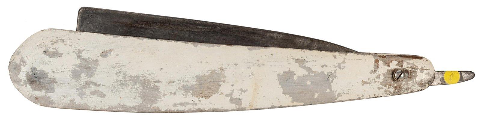 Wooden and Zinc Straight Razor Trade Figure.