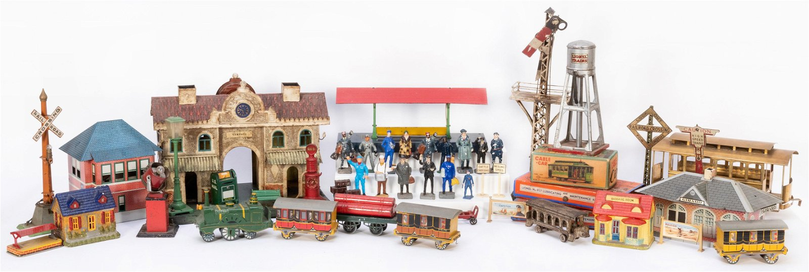 Large Group of Vintage Toy Train Cars and Accessories.