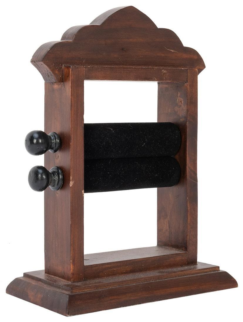 Wooden Money Maker. Modern. Paper cranked through the